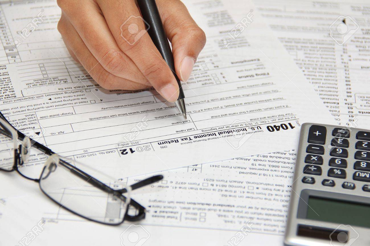 Person Filling 1040 Federal Tax Form Stock Photo Picture And
