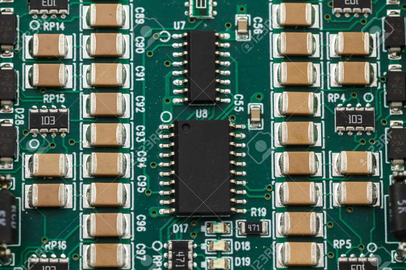 Printed circuit board with ICs, chip capacitors, and chip resistors