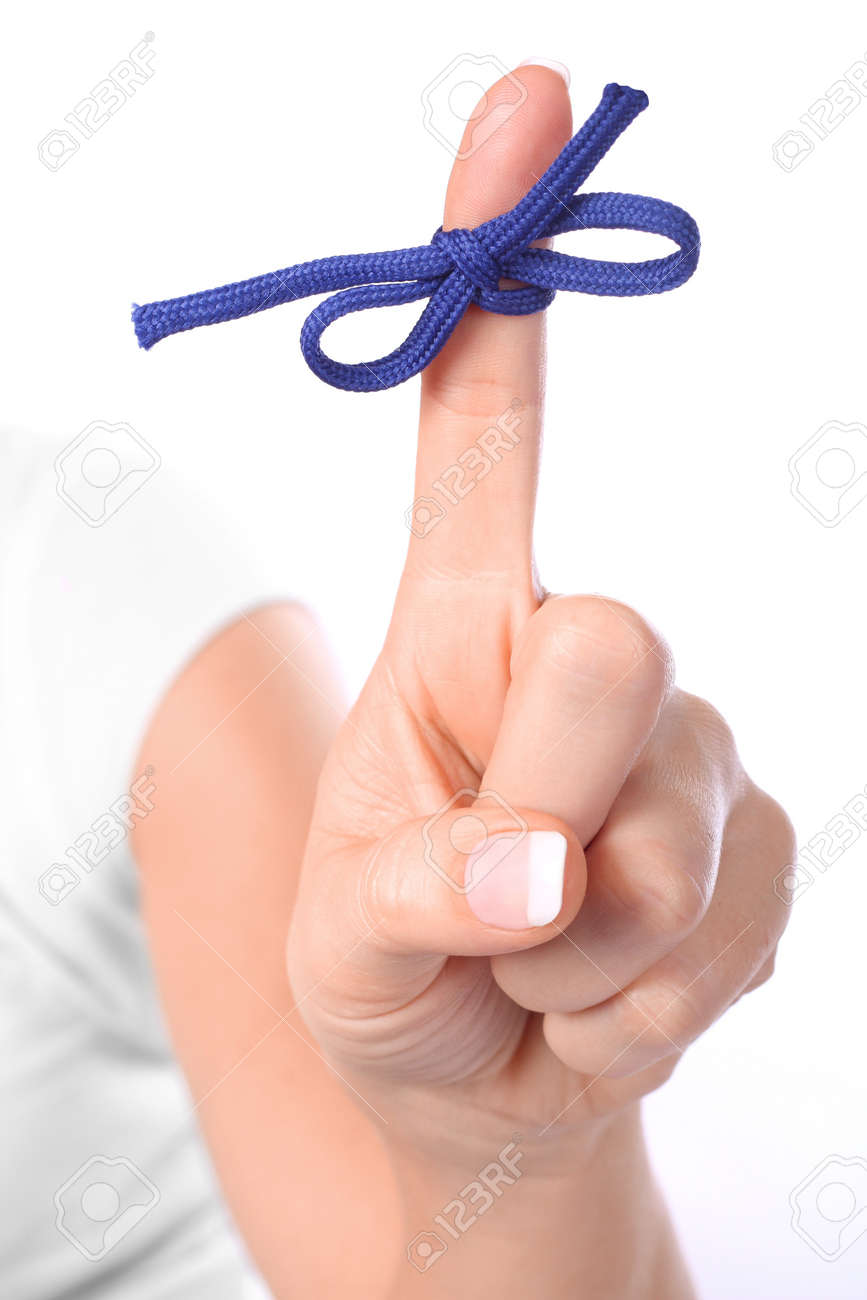 A finger contains a bow-tied string as a reminder to perform a specific task Stock Photo - 3973491