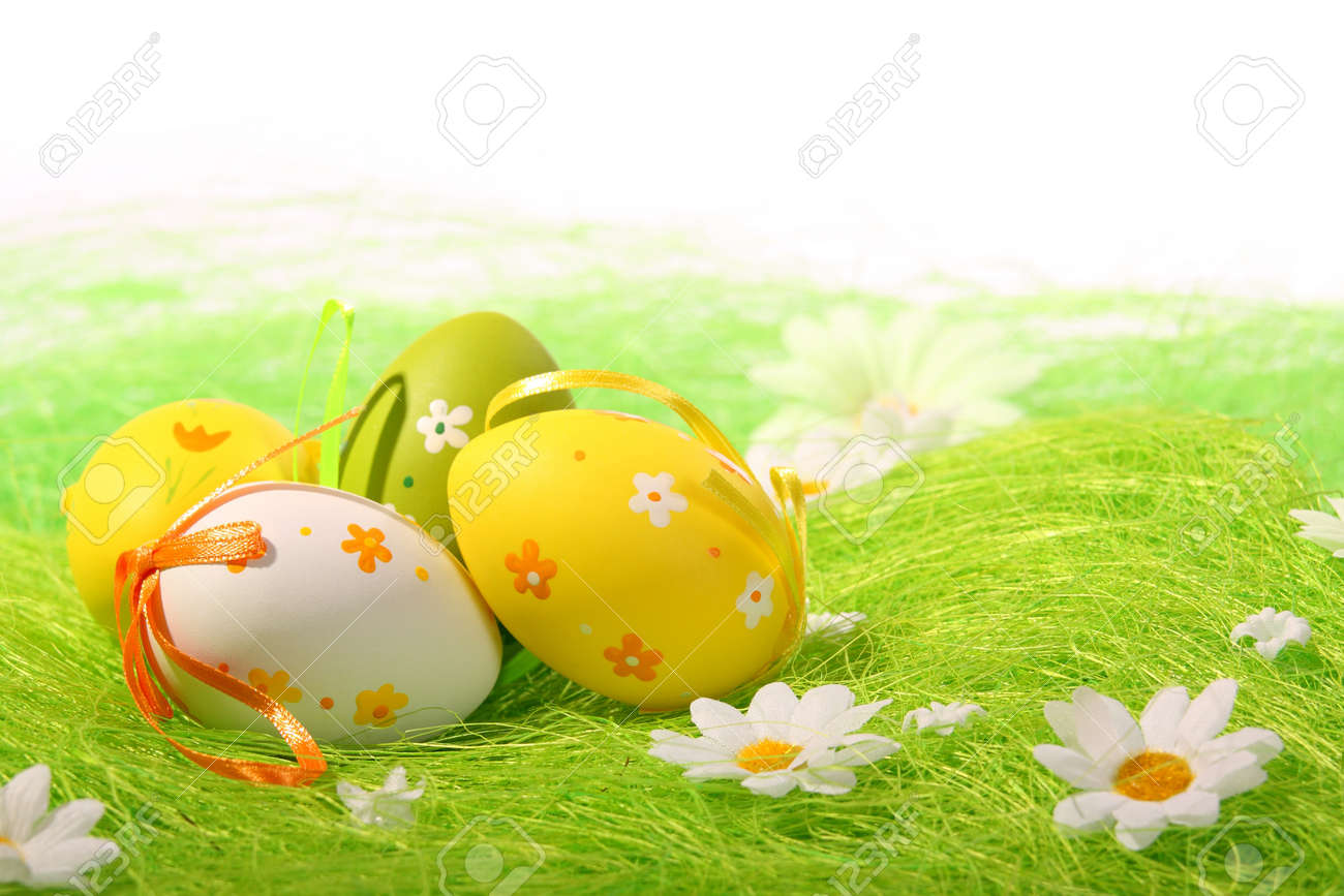 Painted Colorful Easter Eggs on green Grass - 4382157
