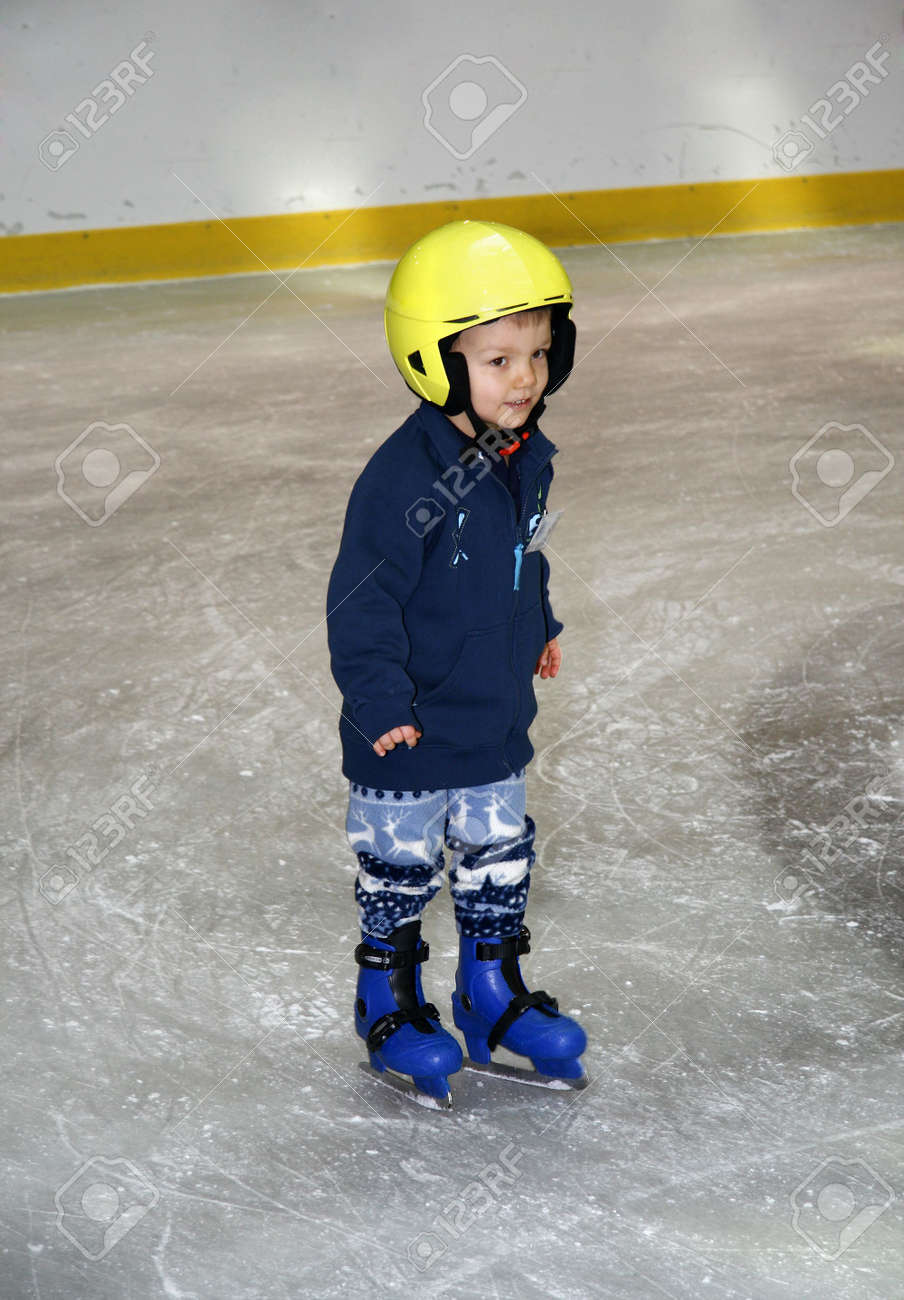 winter time. Young boy learning to skate - 5102542