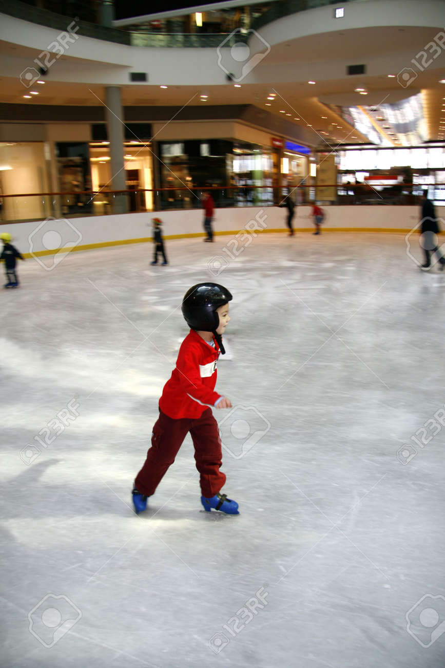 Winter time. Young boy learning to skate - 5102562