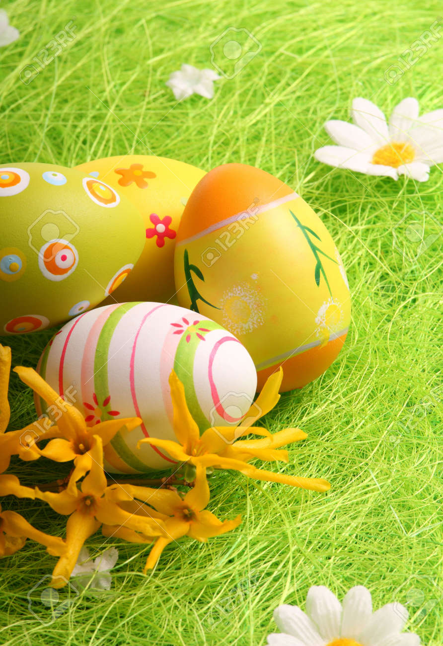 Easter Eggs sitting on grass field - close up - 6484373