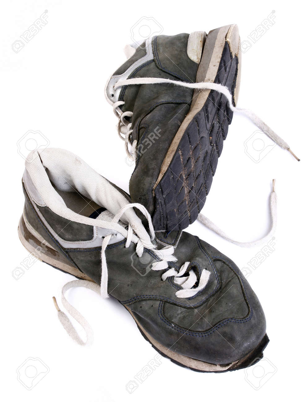Old grungy Running Shoes isolated on white background Stock Photo - 8606363