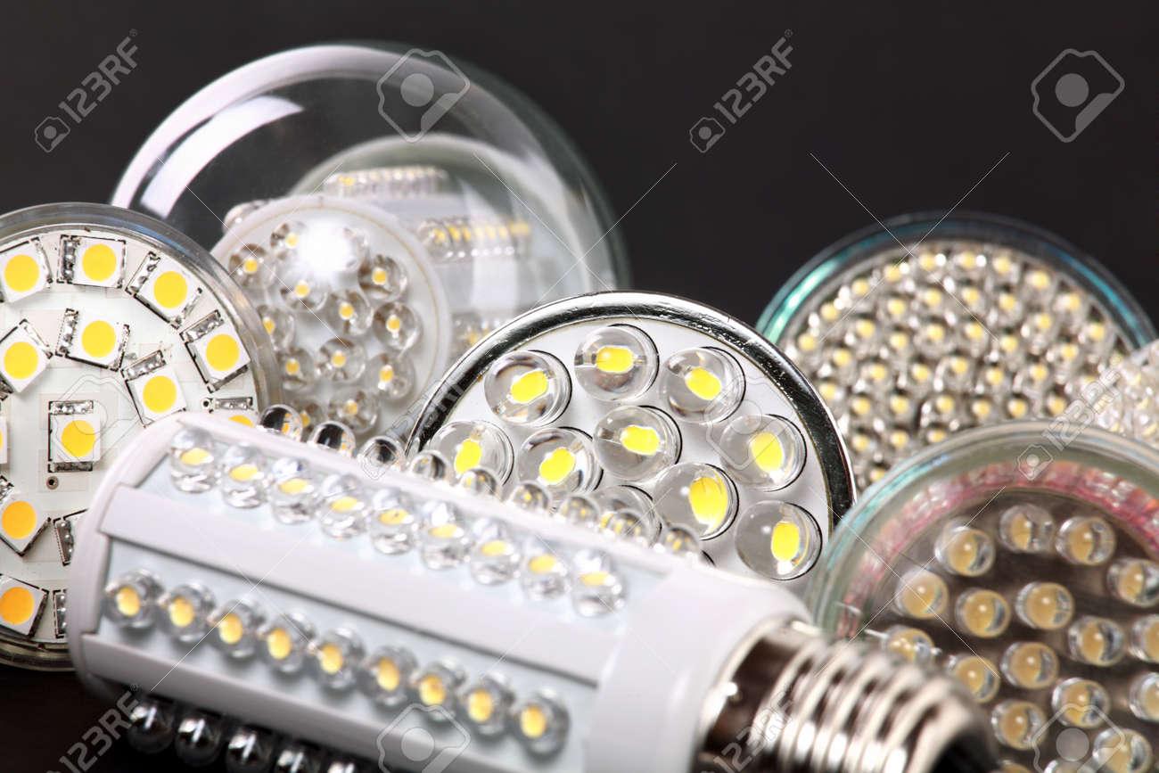 Newest LED light bulb on black background - 11917212
