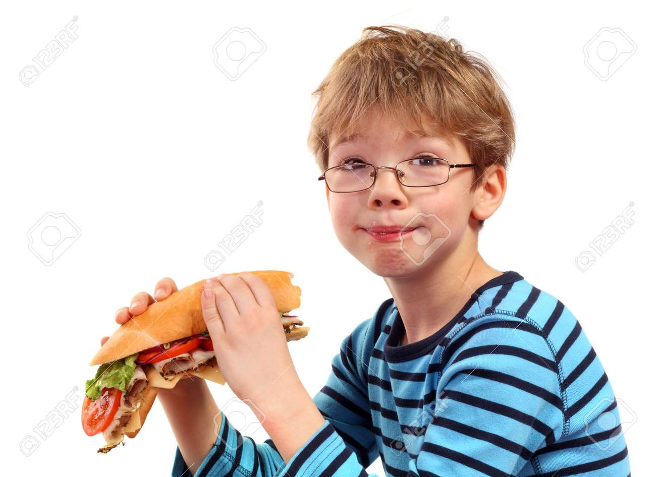 boy eating large sandwich on white background Stock Photo - 11917164