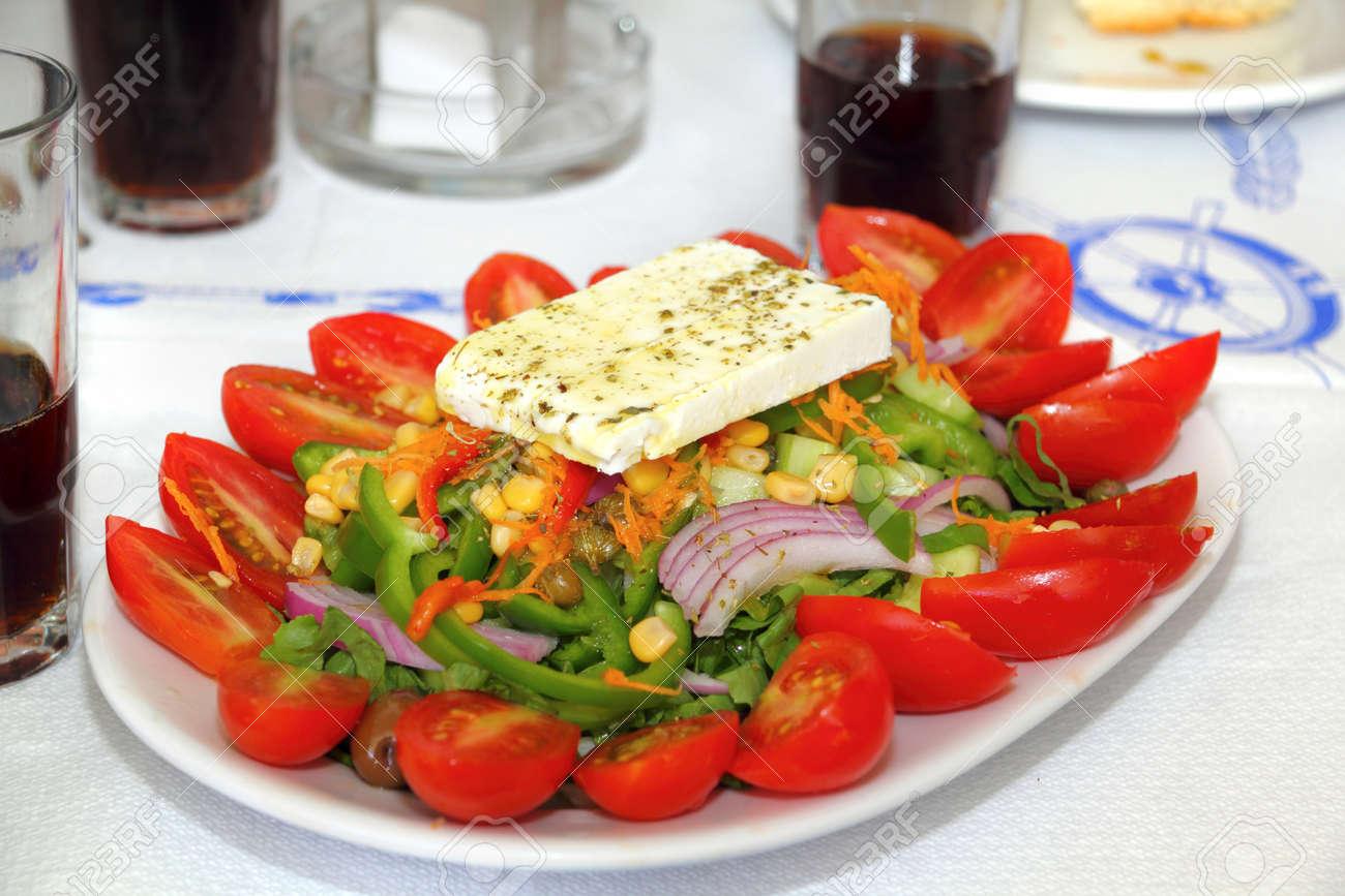 greek salad with feta cheese slice in taverna restaurant as photographed in santorini greek islands - 15845099