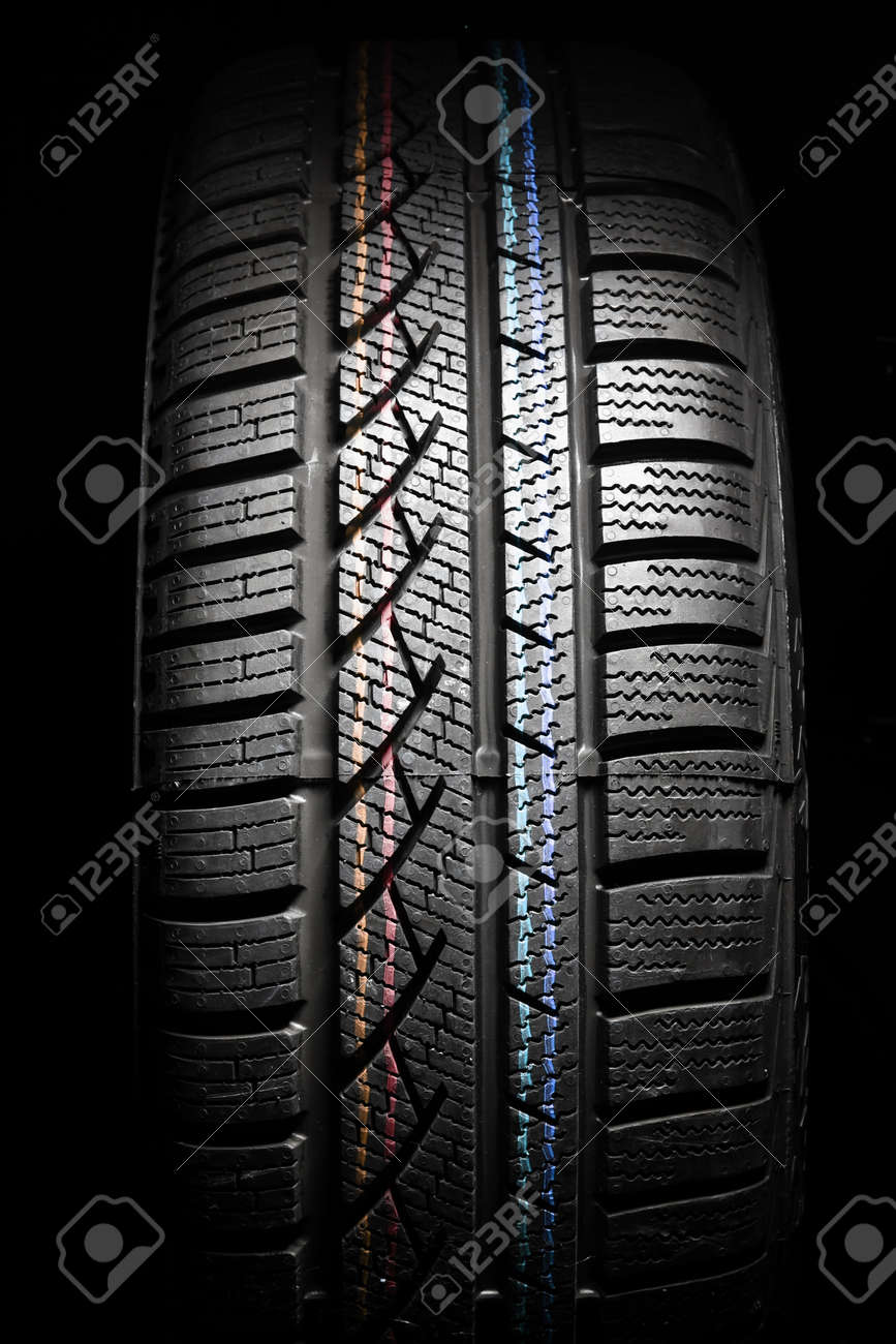 Close up of new winter tire on black - 15979695