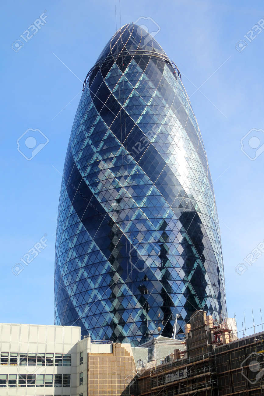 The modern glass buildings of the Swiss Re Gherkin in London, England Stock  Photo -