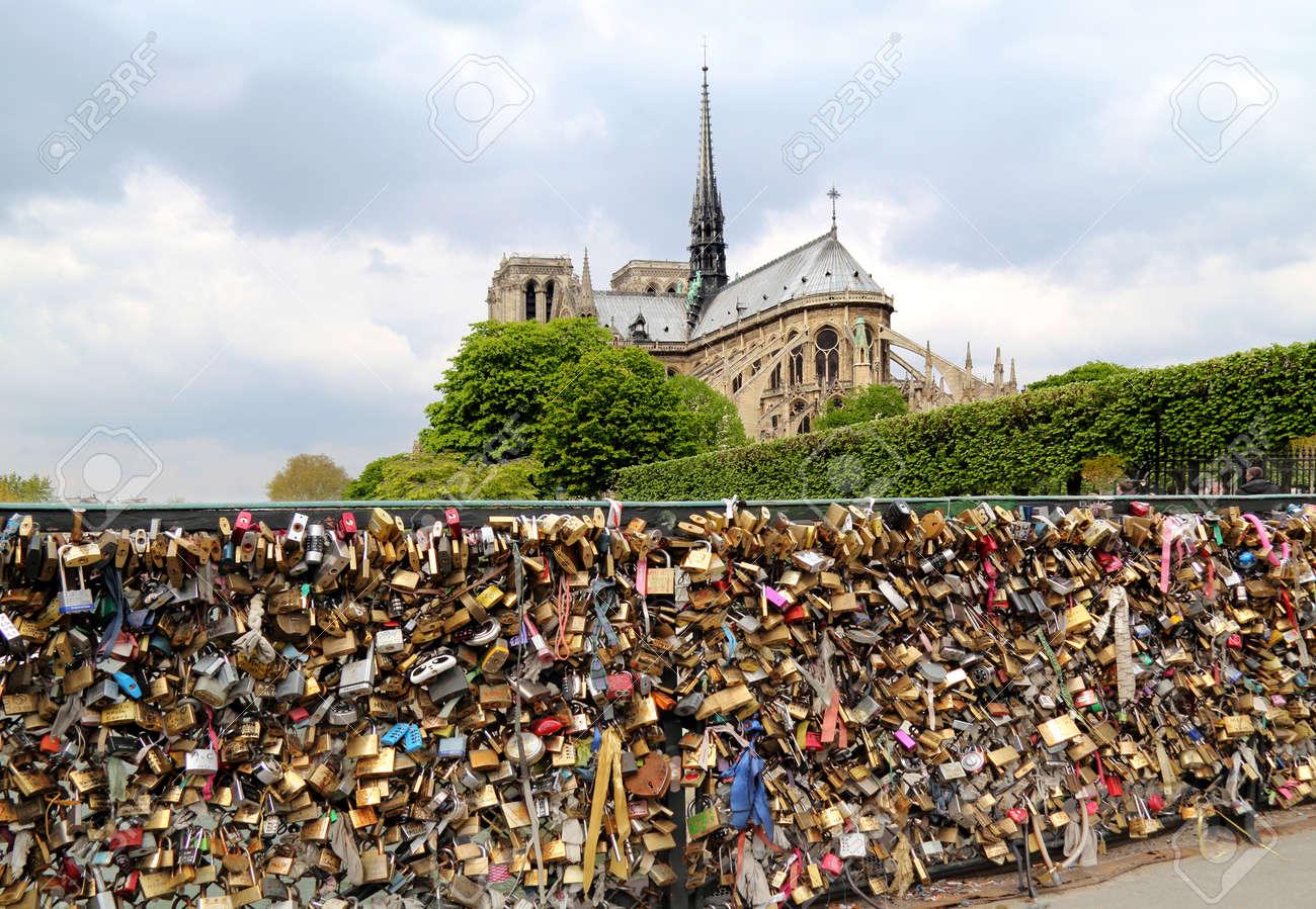 PARIS, FRANCE - APRIL 28: Pont de l Archeveche with love padlocks in Paris on April 28, 2013. The Pont de l'Archeveche is the narrowest road bridge in Paris and it was built in 1828 - 24795785