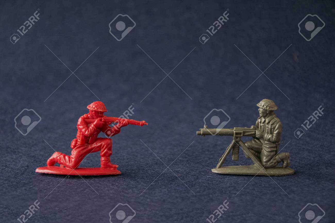 Miniature toy soldiers fighting  Plastic toy military men models