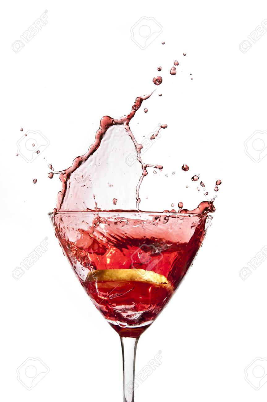 A slice of lemon splashing when dropped into a cocktail Stock Photo - 13200336