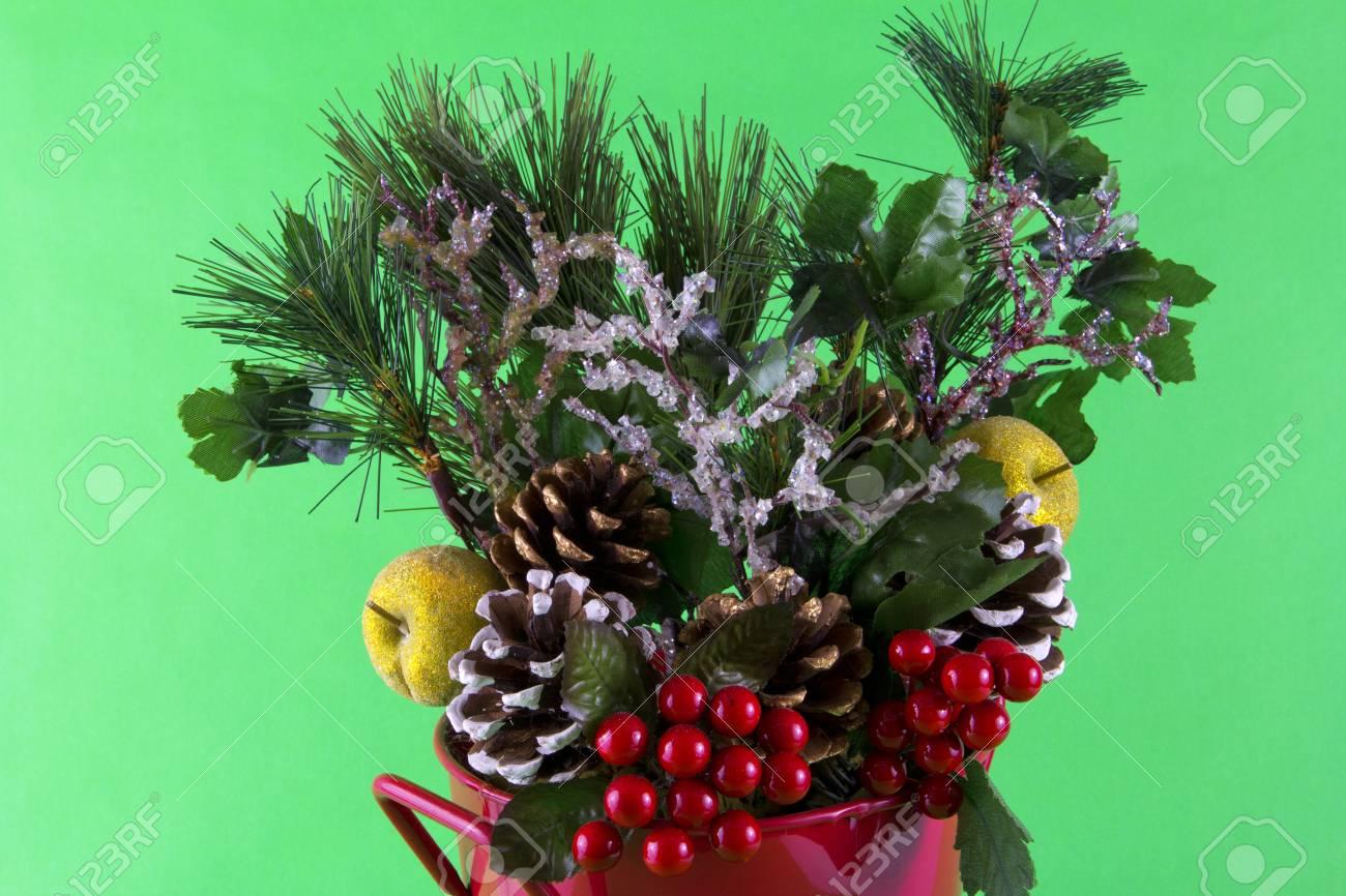A Christmas Arrangement.A Close Up Of A Christmas Arrangement On A Green Background