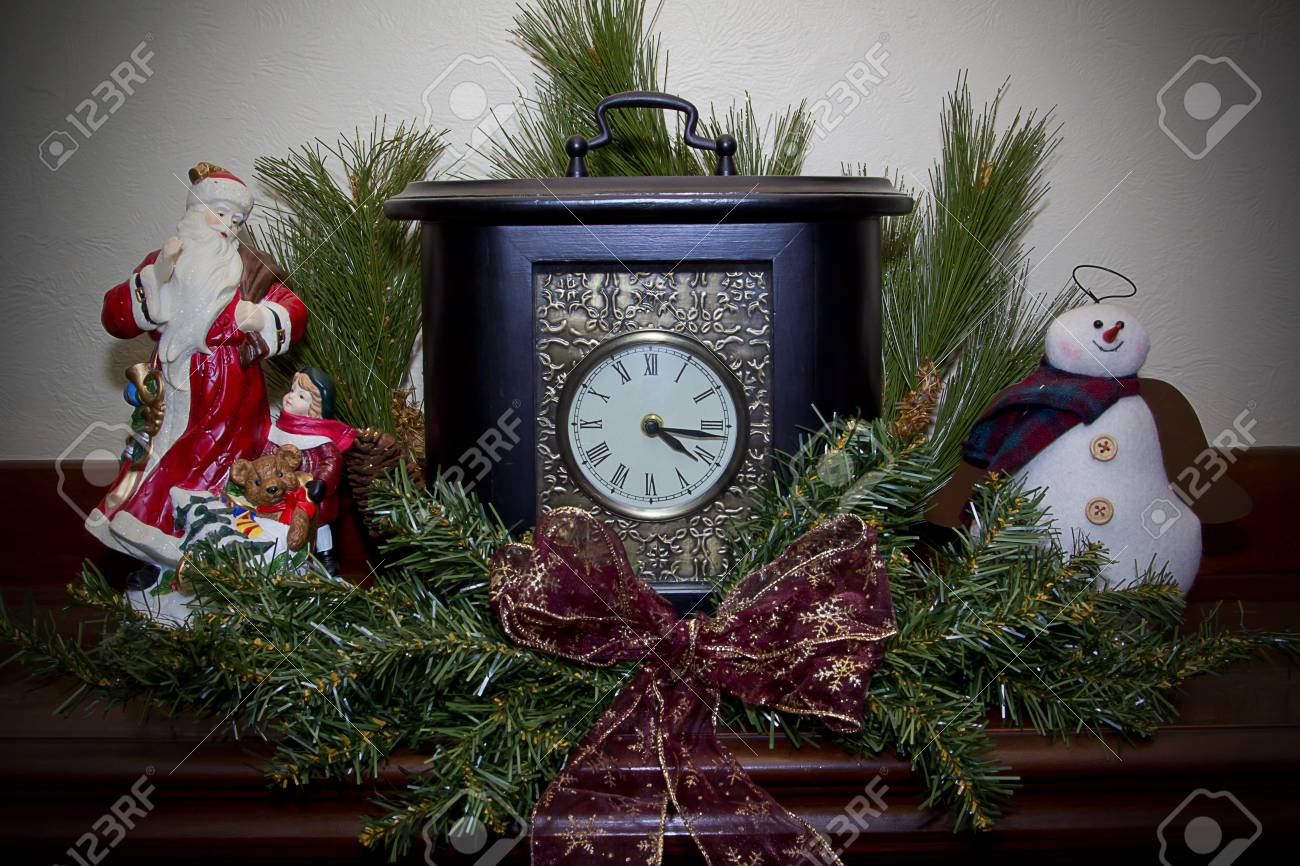 Clock On A Fireplace Mantel Decorated For Christmas Stock Photo Picture And Royalty Free Image Image 32566732