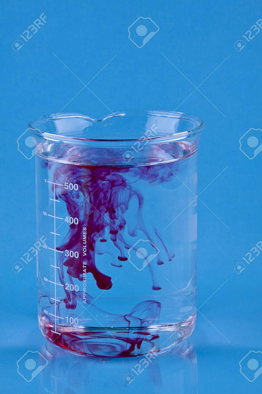 Red Food Coloring Dropped Into A Beaker Of Water. Stock Photo ...