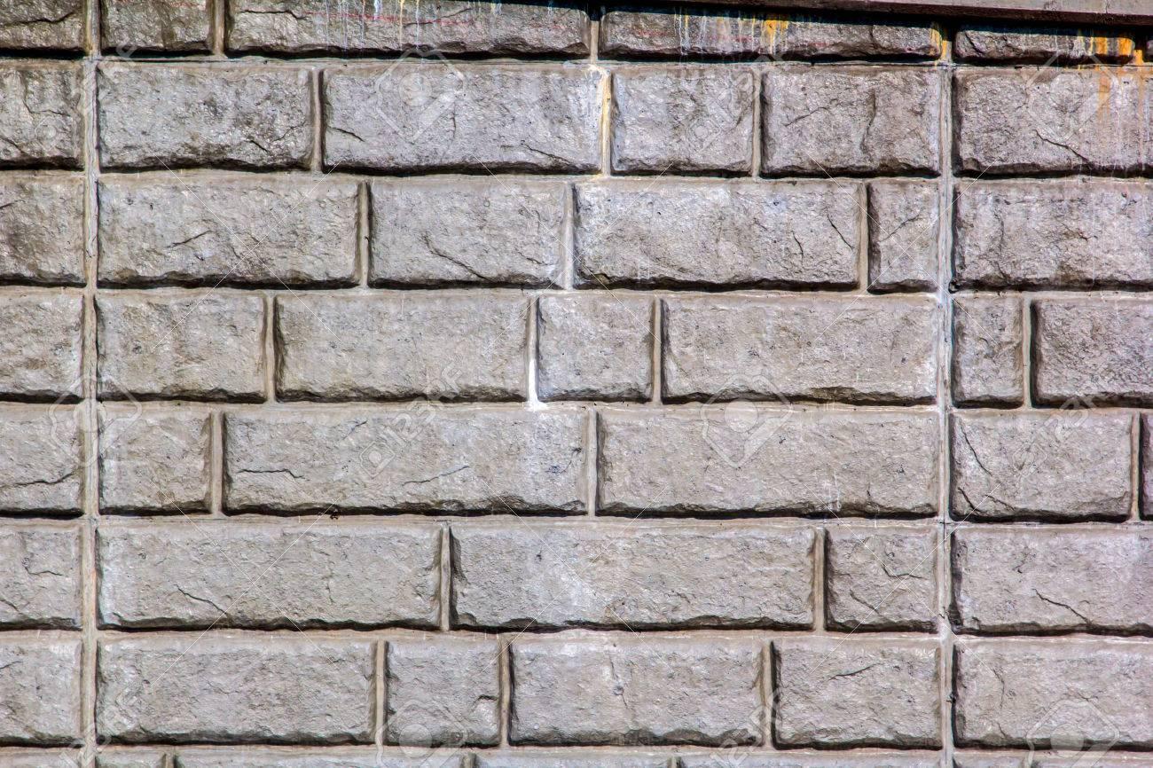 Die Stein-Muster Einer Backstein Stützmauer Lizenzfreie Fotos ...