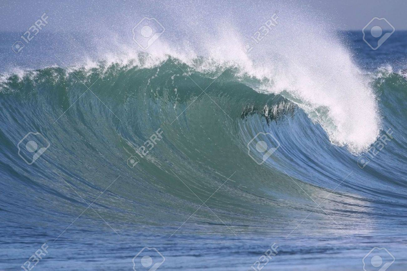 powerful wave breaking near the shore Stock Photo - 4823269