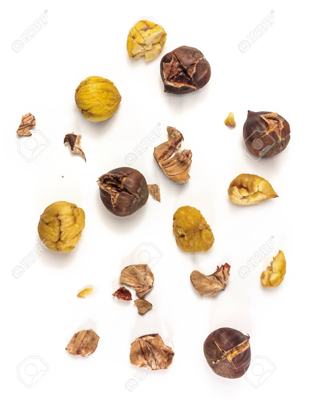 A photo of peeled and unpeeled roasted chestnuts, shot from above on white background - 68334537