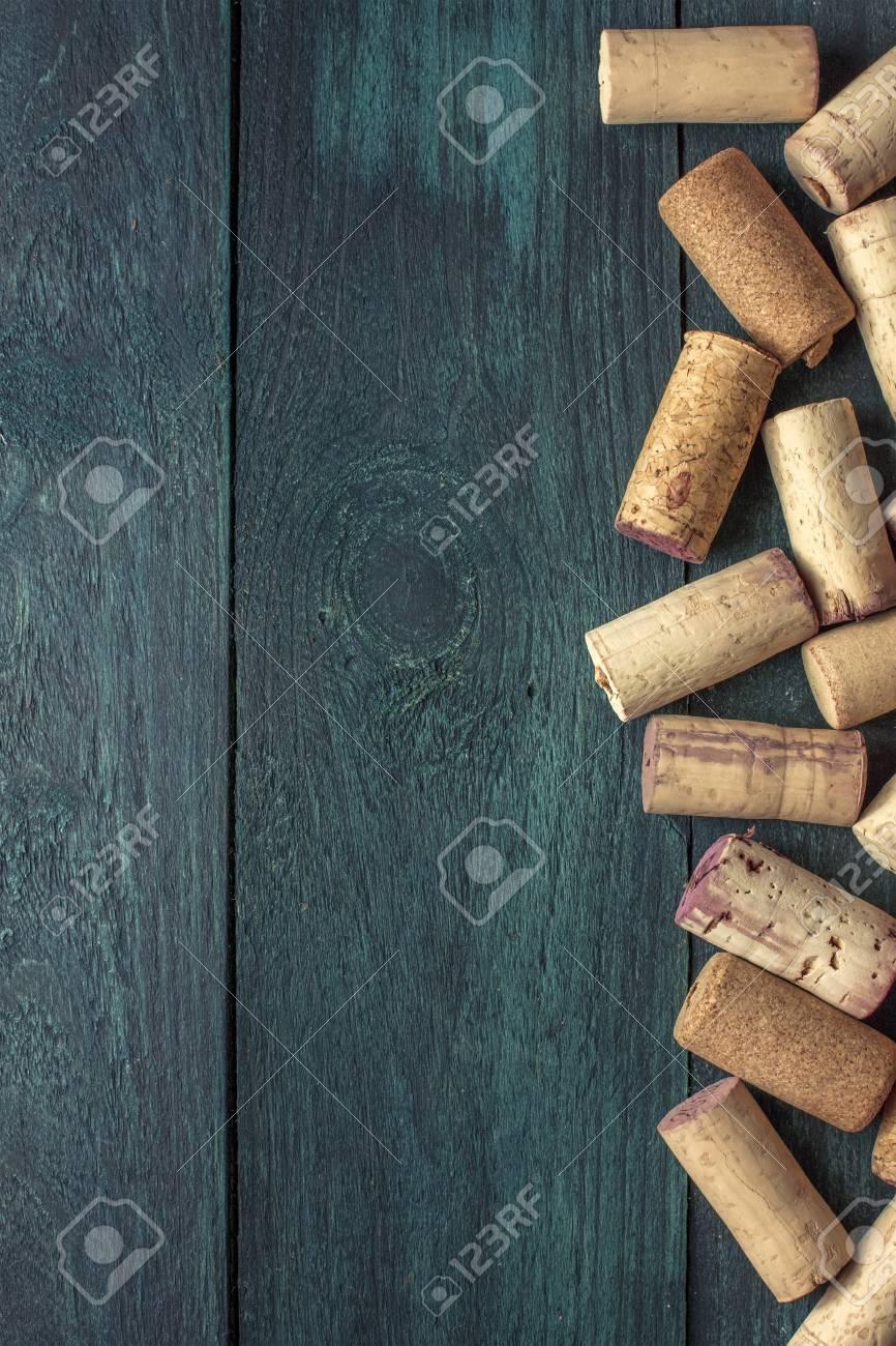 Wine corks on dark wooden texture with copyspace - 69606475