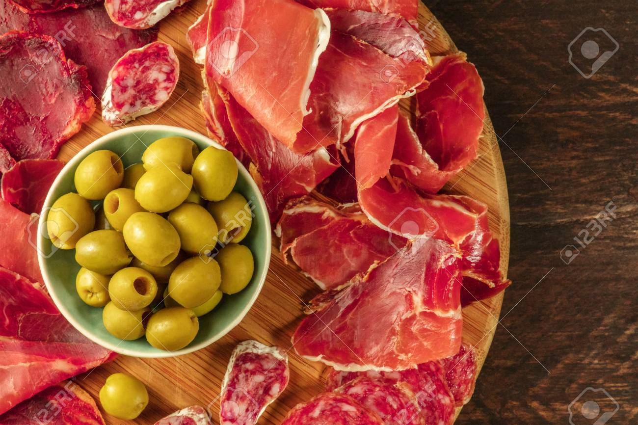 Overhead photo of Spanish cold meats platter with copyspace - 79312469