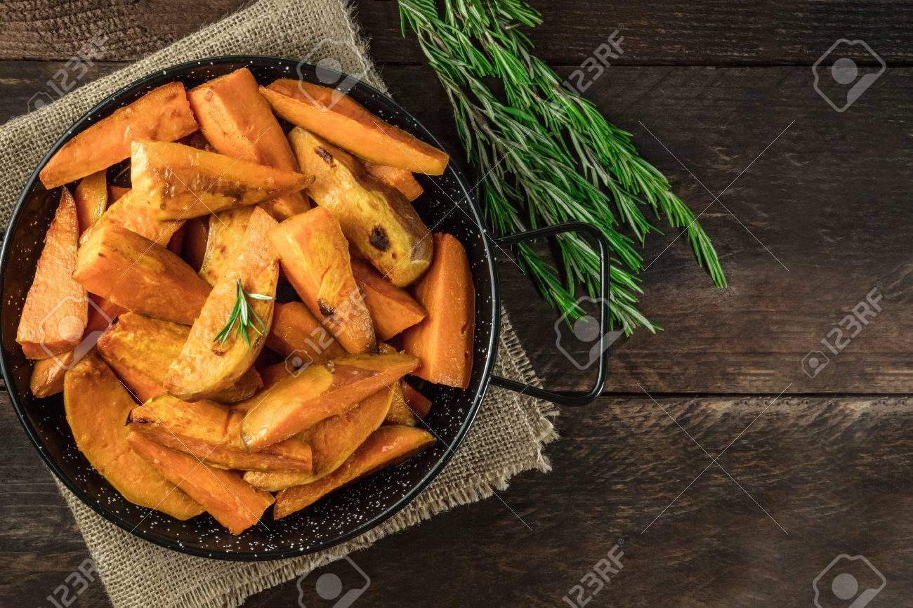 Overhead photo of roasted sweet potatoes in pan - 79548602