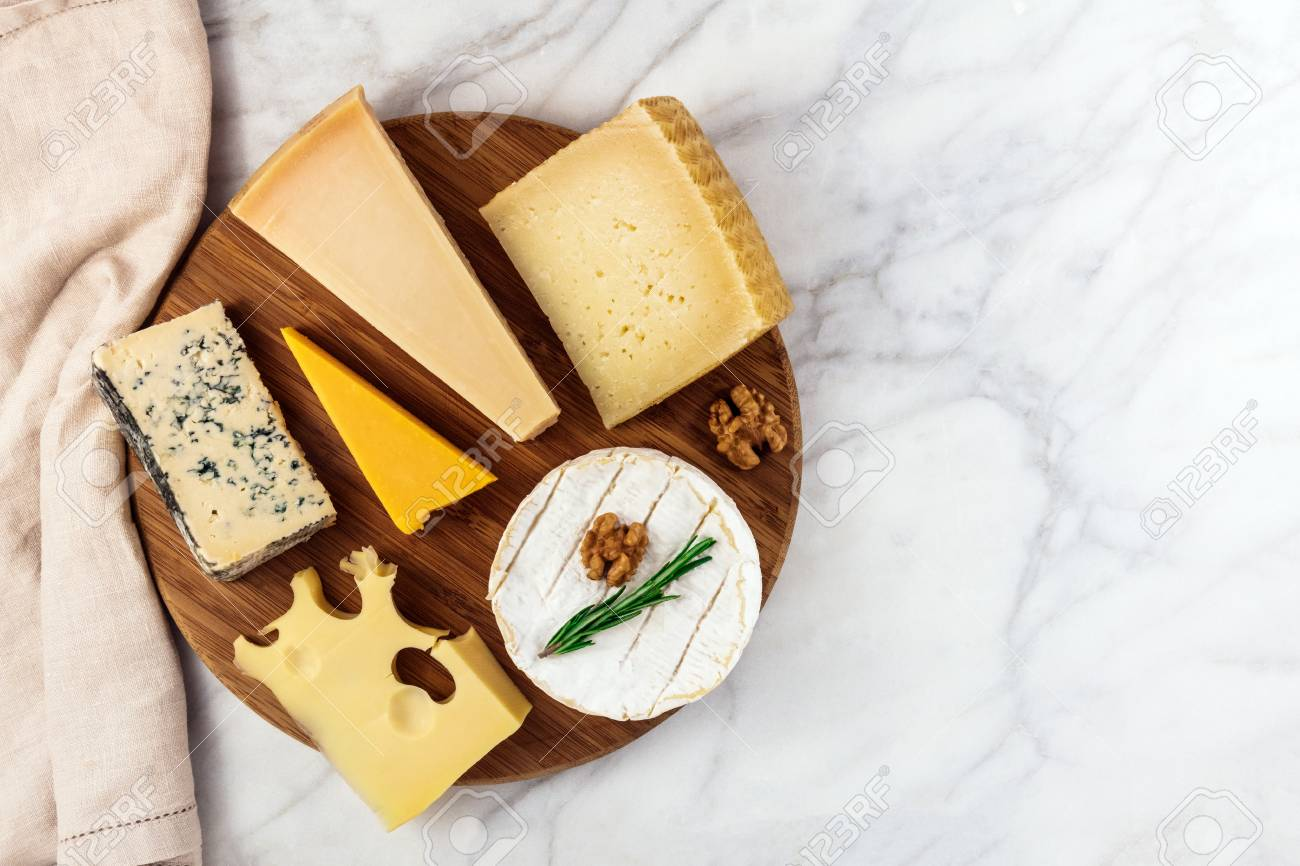 Selection of cheeses on white marble table with copyspace - 80959356