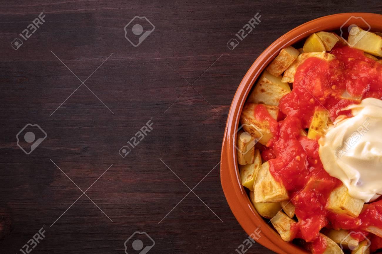 Patatas bravas, Spanish potato dish, overhead closeup shot - 87815178