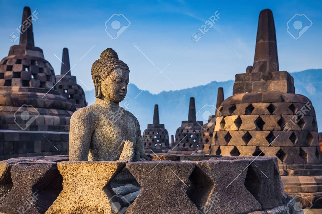 Ancient Buddha statue and stupa at Borobudur temple in Yogyakarta, Java, Indonesia. - 62916519