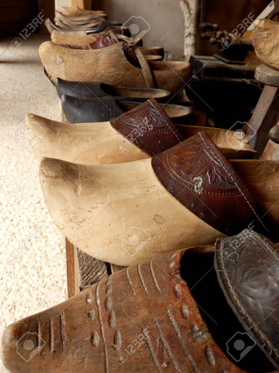 nice shoes official no sale tax Line of vintage clogs in a workshop