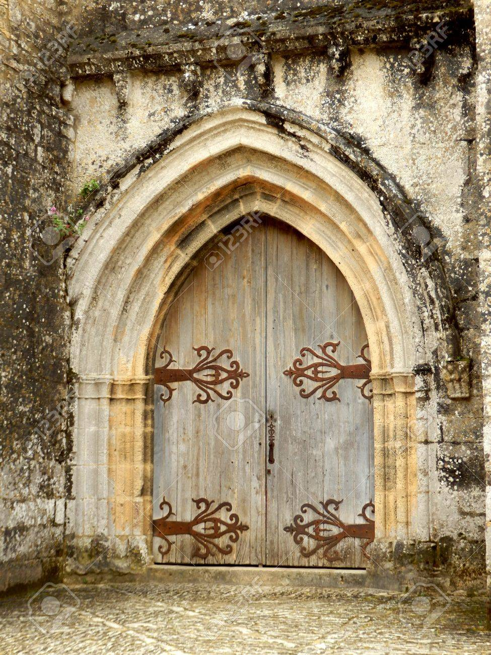 Medieval arched double doors, located at Chateau de Beynac et Cazenac, Dordogne, France Stock Photo - 20367217