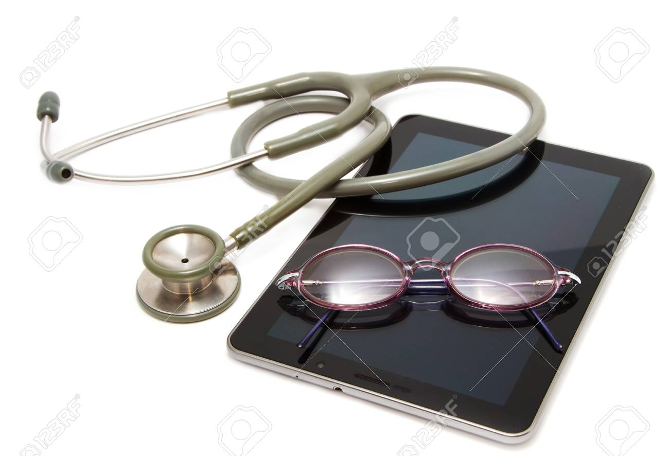 stethoscope and glasses rest on tablet ,for modern diagnostic Stock Photo - 15089844