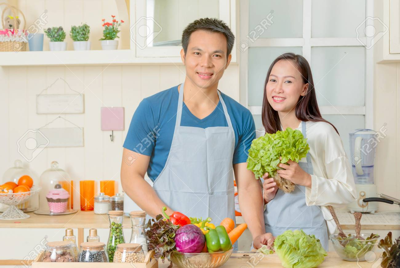 Happy Couple Cooking Together, Couple Preparing Salad With Fresh ...