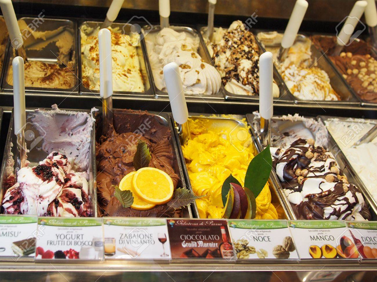 San Gimignano, Italy – October 10, 2010: Ice cream flavours in the world famous ice cream shop 'Gelateria di Piazza' at the central square in San Gimignano, which has won several international prizes, including the 'Ice Cream World Championship' Stock Photo - 9286741