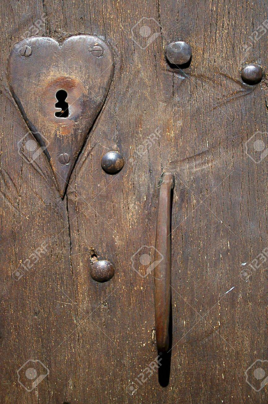 Close-up fragment of ancient door with lock- keyhole Stock Photo - 13060287