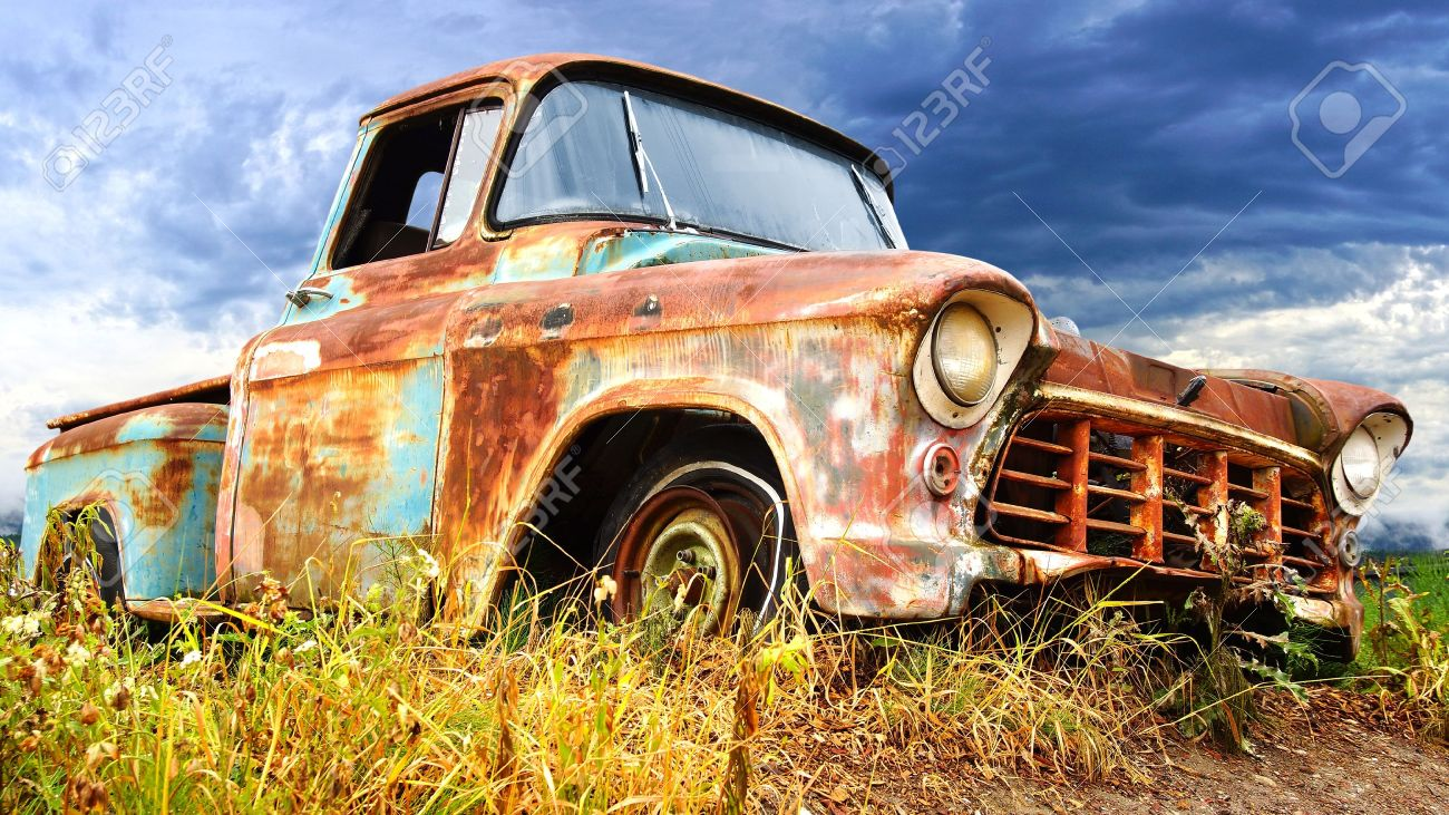Picturesque rural  landscape with old fashioned car Stock Photo - 14443094