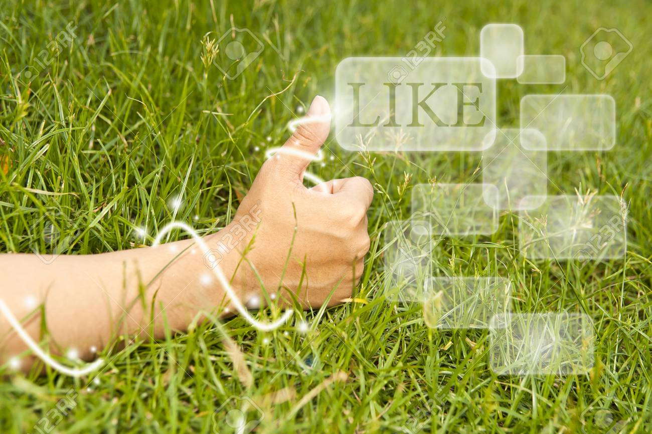 Hand finger Like on green grass . Stock Photo - 13127638