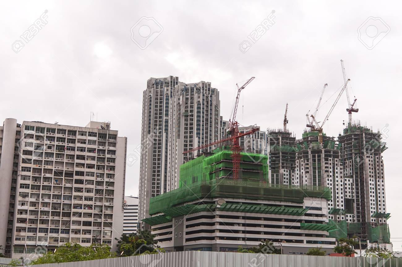 Buildings under construction and cranes under a blue sky Stock Photo - 14129324