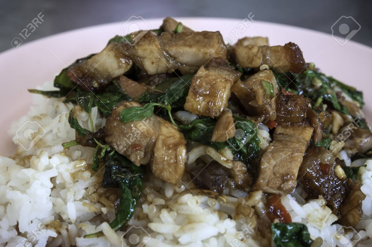 Rice with stir fried hot and spicy pork with basil Stock Photo - 18230634