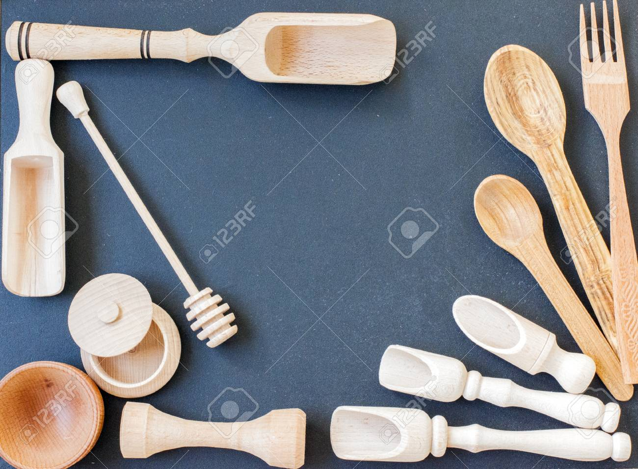 Set Of The Wooden Kitchen Utensils On Black Wooden Background ...