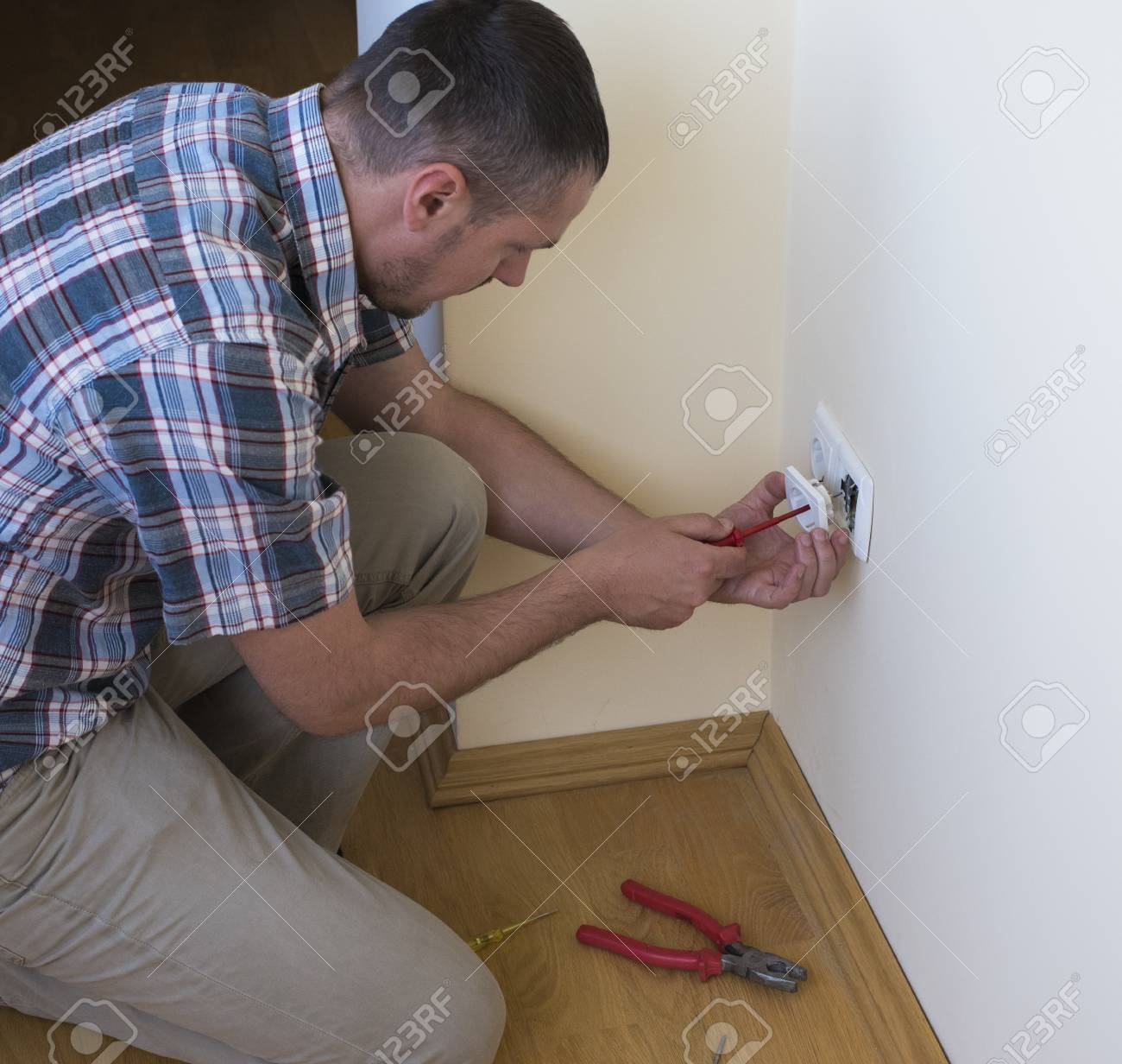 Electrician Installing New Current Socket With Screwdriver ...