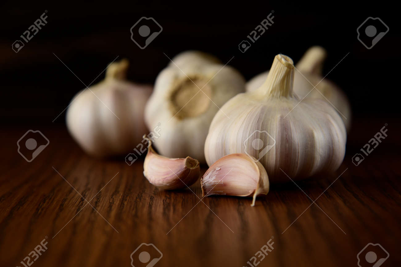 Garlic bulb on the wooden vintage background - 131535288