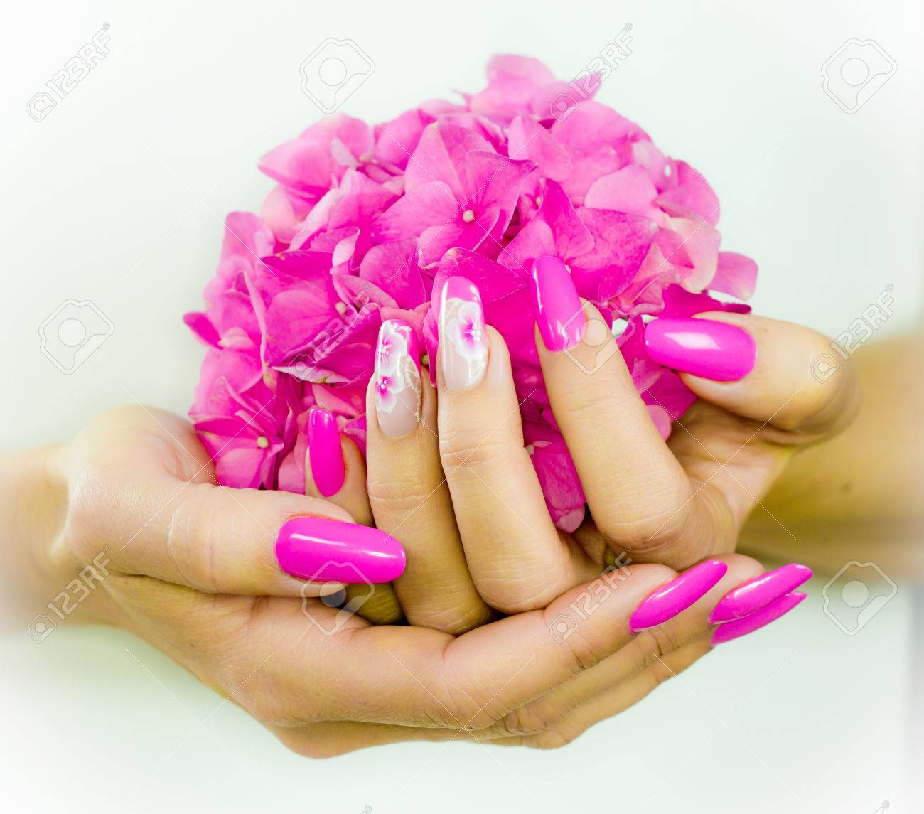 Colored Nails With Pink Flowers Decorations To Celebrate The.. Stock ...