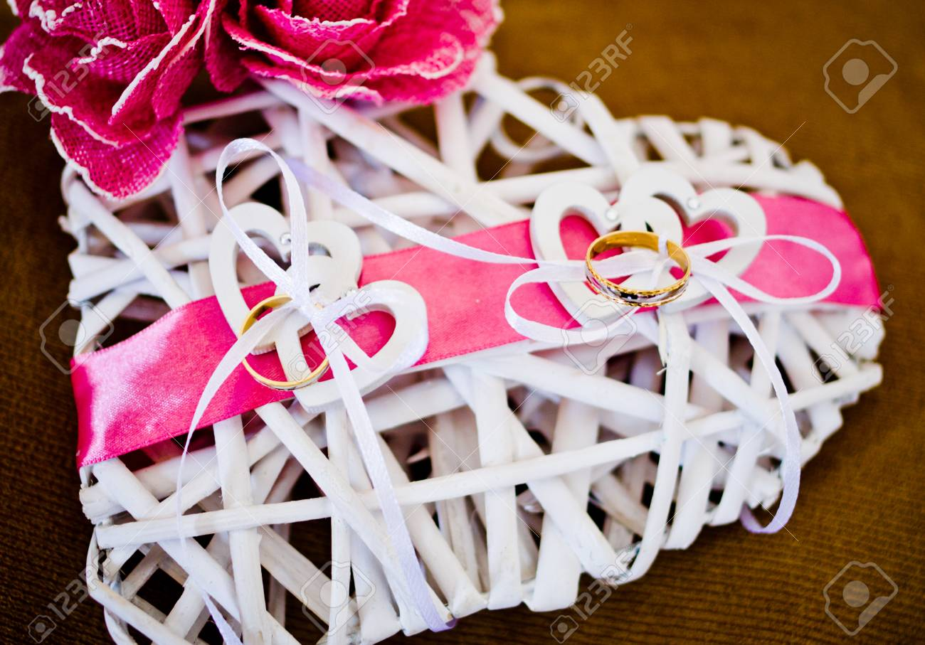 White Wooden Heart-shaped Pillow With Flowers And Pink Ribbons ...