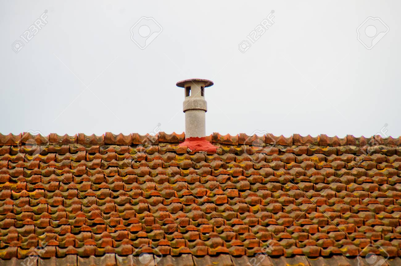 roof vent stopped with cement on the roof with red brick roof