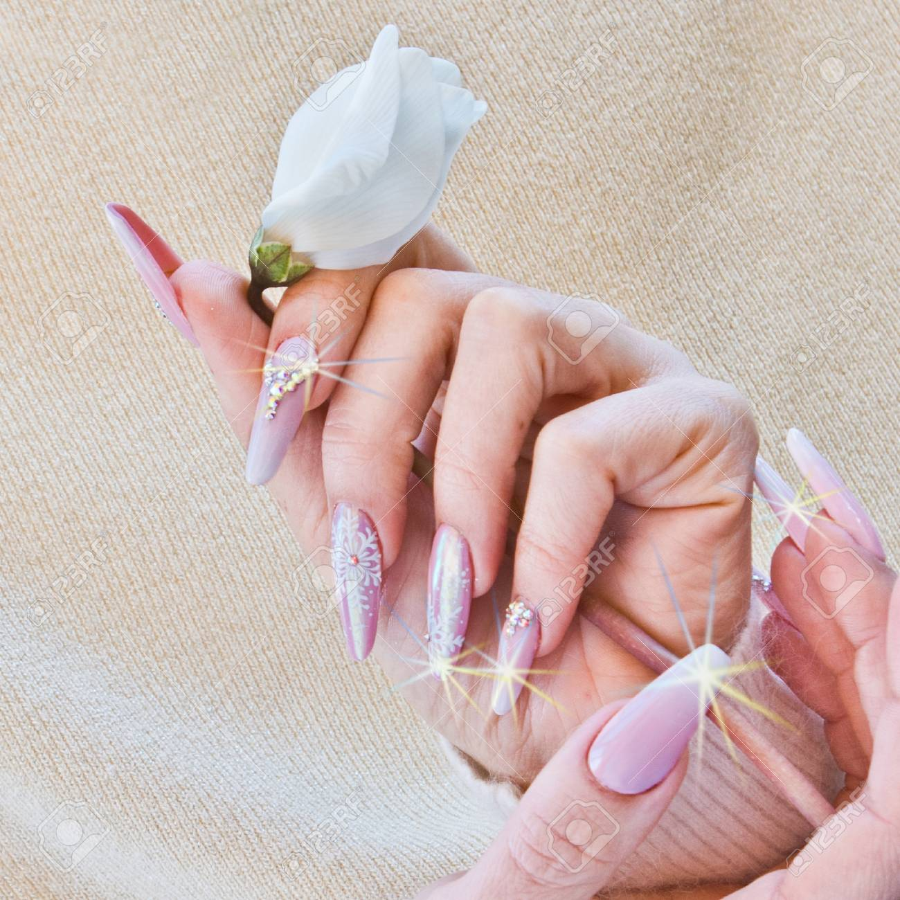 Hands With Nails Decorated With Pink And Brilliant Designs That ...