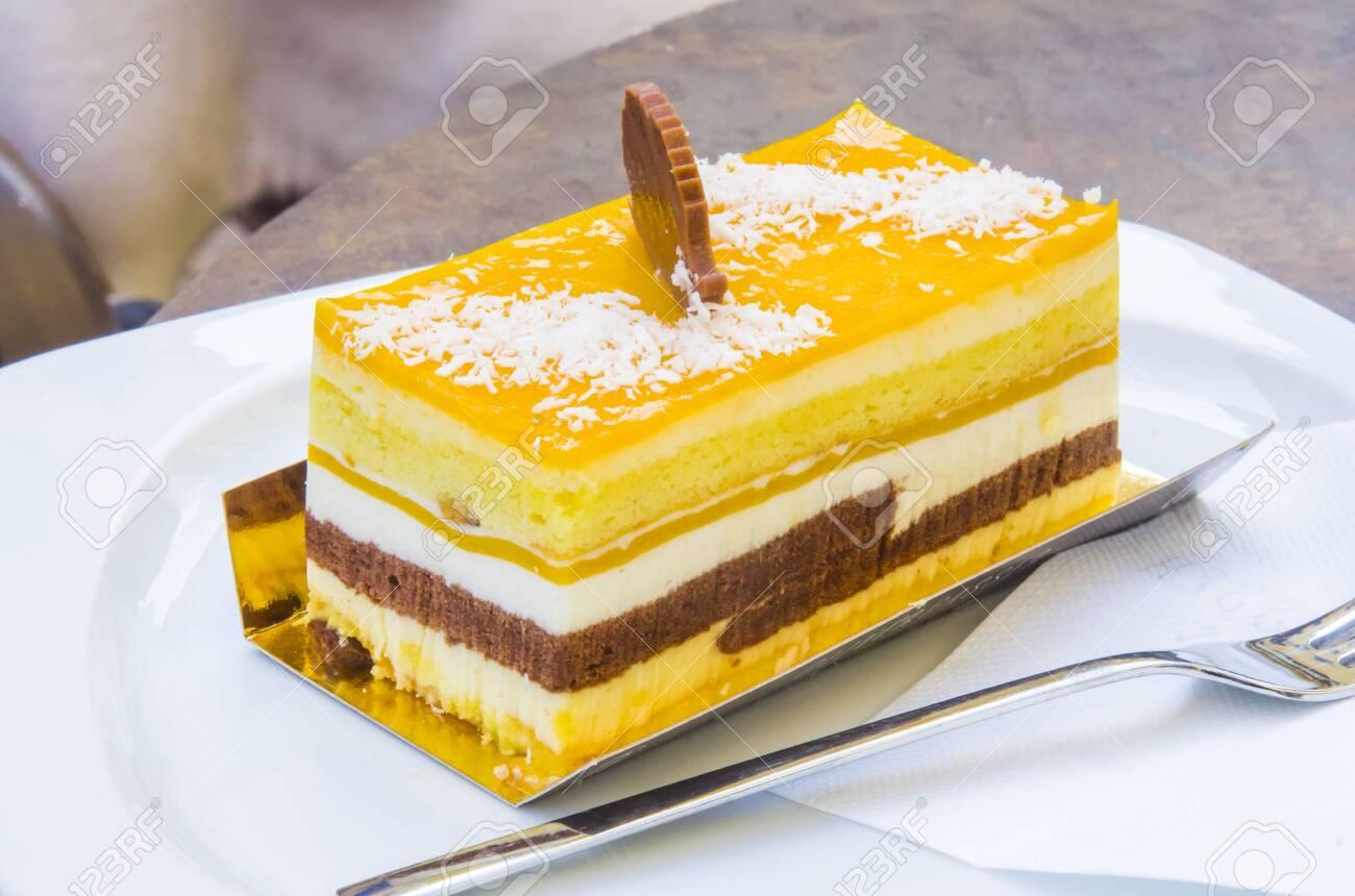 chocolate parfait, sponge cake, cream and mango with a milk chocolate hedgehog decoration - 145781620