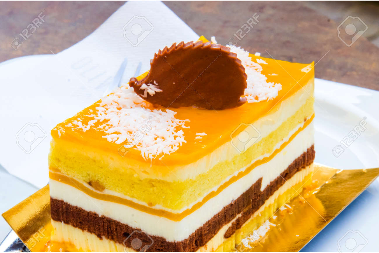chocolate parfait, sponge cake, cream and mango with a milk chocolate hedgehog decoration - 145781621