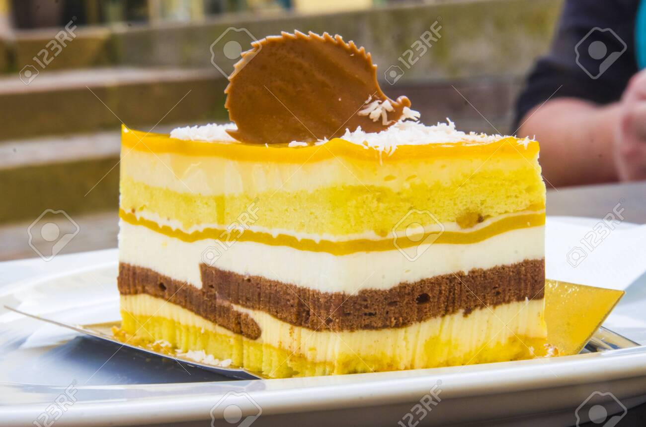 chocolate parfait, sponge cake, cream and mango with a milk chocolate hedgehog decoration - 145782234