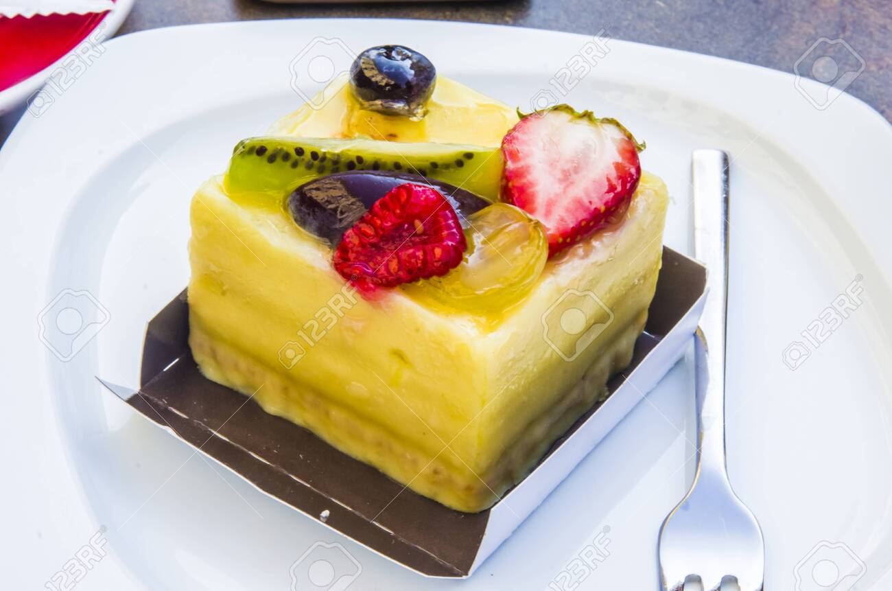 cake, passion fruit semifreddo cube with strawberry, kiwi, grapes, plum, blackberry and cape gooseberries - 147457341