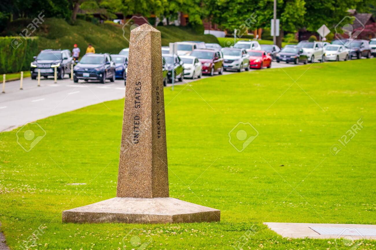 Surrey, British Columbia, Canada - July 7, 2018: Boundary Marker at the Canada–United States border - 141528458